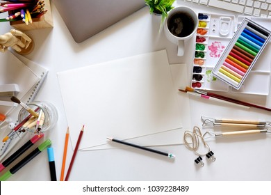 Conceptual image of Artist graphic designer workplace white table.