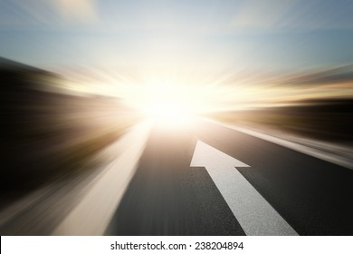 Conceptual image of asphalt road and direction arrow