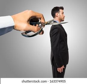 Conceptual image of a boss firing an employee