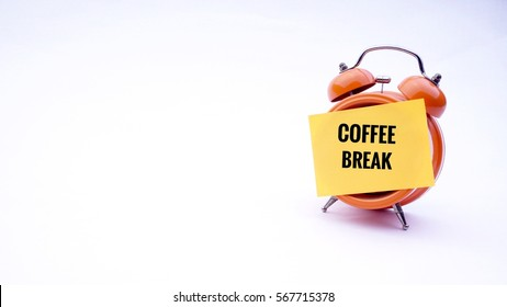 "Conceptual image of Business Concept with words "" Coffee Break!"" on a clock with a white background. Selective focus."