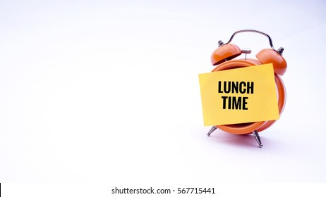 "Conceptual image of Business Concept with words "" Lunch Time"" on a clock with a white background. Selective focus."