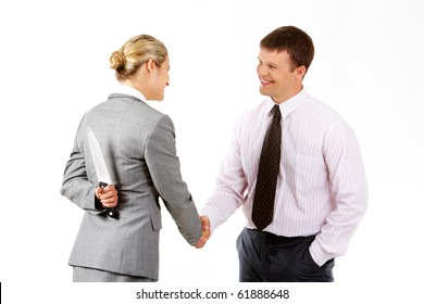 Conceptual image of business woman with knife doing agreement with businessman