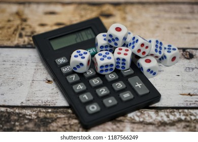 Conceptual image calculator with dice on wooden background. Concept for business risk, chance, good luck or gambling. Text 2019 for New Year. Selective focus.