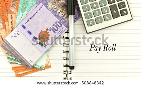 Conceptual Image With Cash Calculator And Notepad With Word P