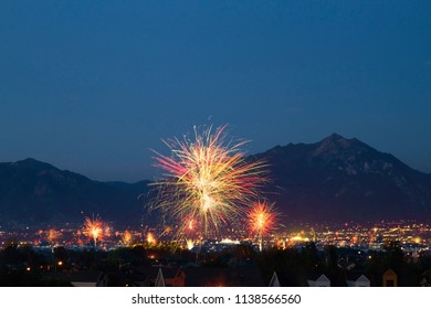 Conceptual image of celebration in Utah, USA. Fireworks in front of the Wasatch mountains. Conceptual image for 4th of July, and Pioneer Day.