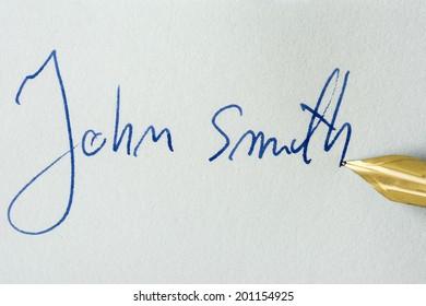 Conceptual image containing a signature made with a pen - John Smith