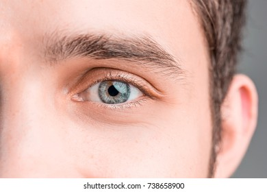 The conceptual image of digital eye of a young man and eoman
