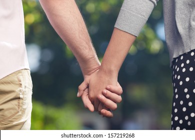 Conceptual image of female and male hands together