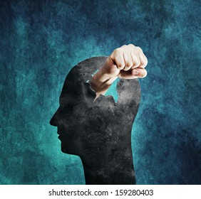 Conceptual image of a fist punching through a cardboard head.