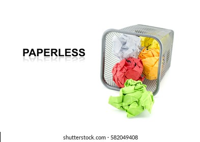 conceptual image of green, red and yellow waste color paper with word PAPERLESS. isolated white background