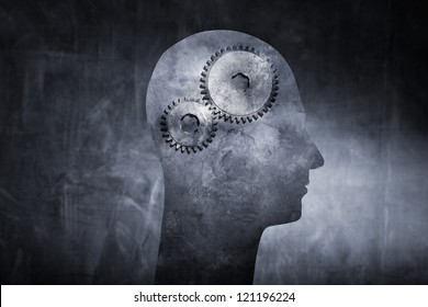 Conceptual image of a head with cog gears as brain.