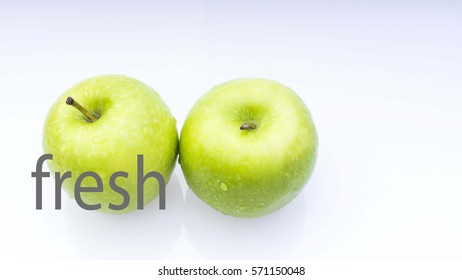 Conceptual image of Healthy Concept with word ' fresh' and apple on a white background. Selective focus.