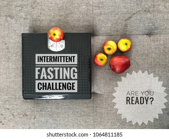 Conceptual image of intermittent fasting challenge with apples and weight scale as symbolic of weight loss