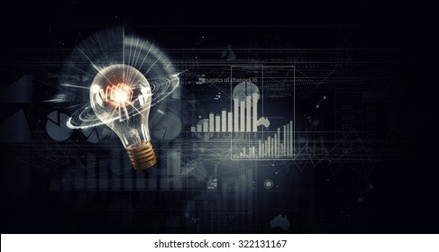 Conceptual image with light bulb on background of diagrams and graphs