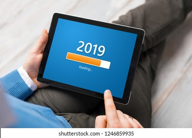 Conceptual image of man looking at tablet and getting ready for New Year.