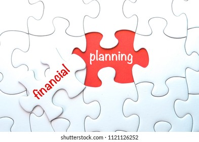 Conceptual image. Missing puzzle with word ' financial planning' on red background.
