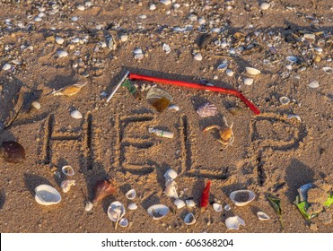 Conceptual image, nature crying out for help, showing text in sand on a beach with the word 'HELP' surrounded by washed up debris.