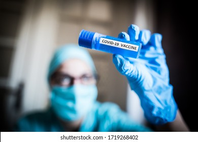 Conceptual image of a nurse holding a recipient with the coronavirus COVID-19 vaccine. - Shutterstock ID 1719268402