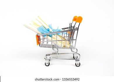 Conceptual image of polemic of fake college degree puchased on-line from unknown universities of few malaysian politicians' credentials. Paper scrolls in trolley isolated over white. Focus on troley.