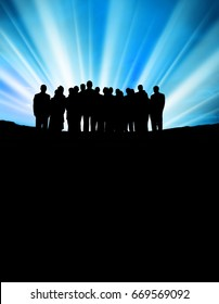 conceptual image of silhouetted group of business people over light beam
