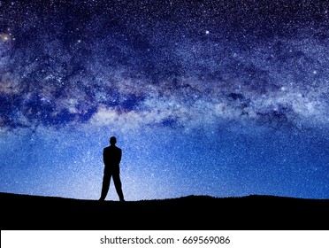 conceptual image of silhouetted man and manipulated abstract universe lights.