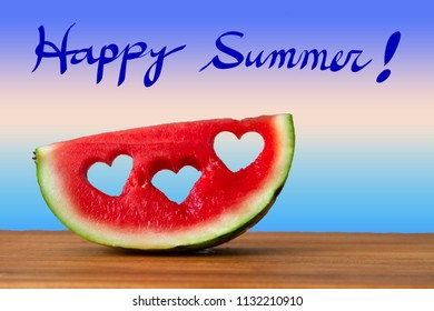 Conceptual image of summer with Watermelon with heart shapes.  Happy Summer handwriting with blue gradient background.