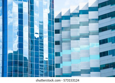 Conceptual image of textured facade of modern design skyscraper office buildings in city business district, reflection in futuristic window surface pattern background and copy space.