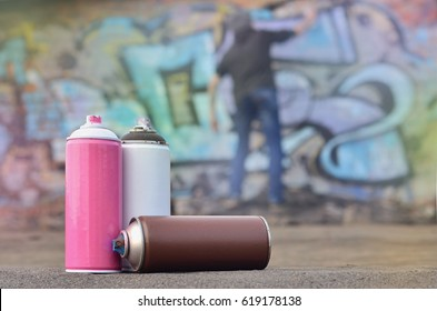 "A conceptual image that shows the process of vandalism. The young man spoils the city's property, illegally drawing various drawings on the walls. Hooliganism called ""bombing"" or ""graffiti"""