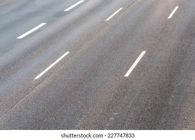 Conceptual image of a three laned empty motorway taken from above