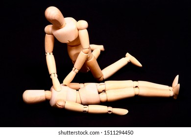 Conceptual image of wooden manikins administering CPR resuscitation