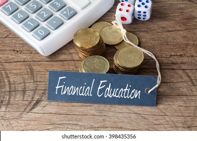 Conceptual image of the words Financial Education written on label tag with coins,dice and calculator