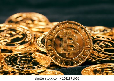 Conceptual image for worldwide cryptocurrency, huge stack physical version of golden Bitcoin