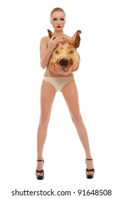 Conceptual image of young beautiful slim sexy woman in stilettos with dead pig's head, over white background