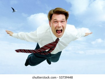 Conceptual image of young businessman shouting while flying in the clouds
