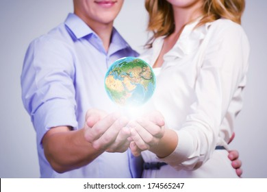 Conceptual image of young couple hugging each other and dreaming. elements of this image are furnished by NASA