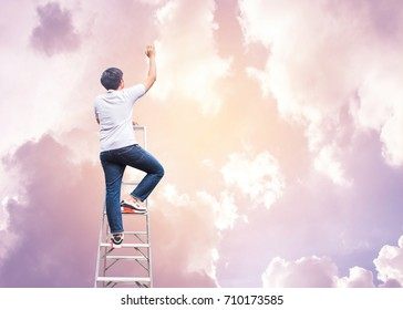 Conceptual image of Young man climb up on ladder and raise hand up to the sky, hope  concept  or christian background human can not go to heaven by their good deed but by the grace of God, copy space