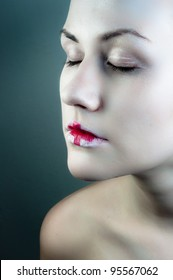 Conceptual makeup on a woman against dark background