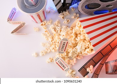 Conceptual objects of cinema on white table and background. Concept of watching movies. Horizontal composition. Top view.