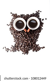 conceptual owl made with coffee beans and cups