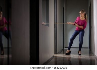 Conceptual photo of angry woman pulling a rope symbolizing business competition