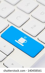 Conceptual Photo Of Coffee Cup On Keyboard.