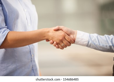 Conceptual photo of finding an agreement by shaking hands