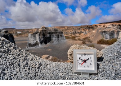 Conceptual Photo Picture of an Alarm Clock Object in the Dry Desert