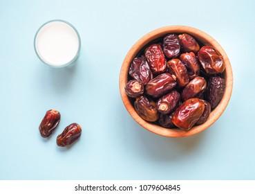 Conceptual photo of Ramadan food: dates palm and milk