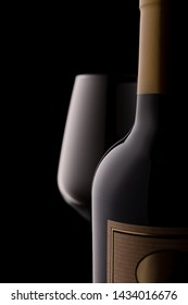 Conceptual photo of red wine and glass, on a black background.