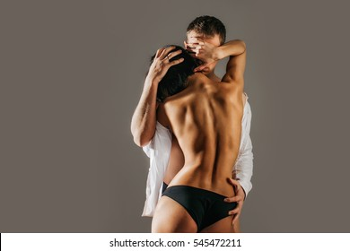 Conceptual photo of sexy elegant couple in the tender passion. Couple having sex. I love when he's kissing of me neck. Love and relationships lifestyle. Close up portrait of young attractive romantic.