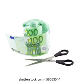 Conceptual photo - toilet paper made from one hundred euro banknotes and scissors, isolated on a white background