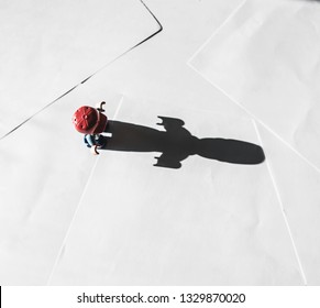 Conceptual photo of toy and his shadow. Choose your way motivational quotes.