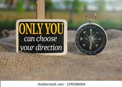 Conceptual Photo Using Compass Written Motivational Stock Photo