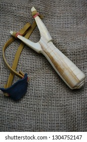 Conceptual photo using slingshot to reminisce of childhood memories. Selectively focused image.
